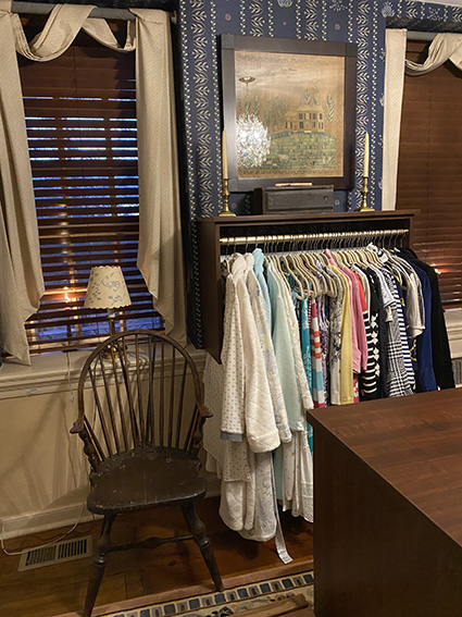 Historical home with closet hanging on fireplace mantle