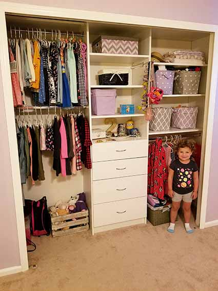 Girl standing by her organized closet system