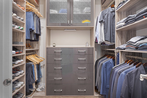 Organized mens custom walk-in closet