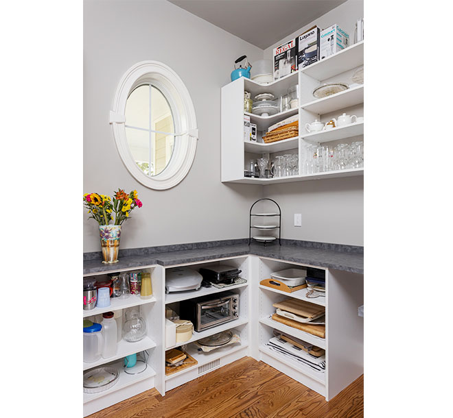 Organized pantry room with l-shaped corner shelving