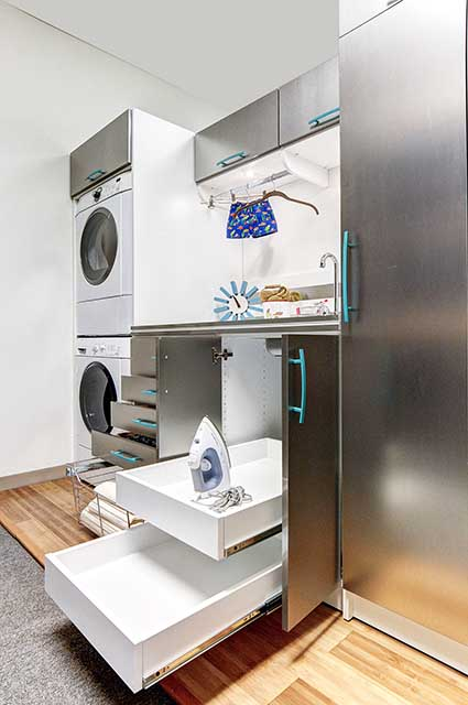 Laundry room with slide out drawers