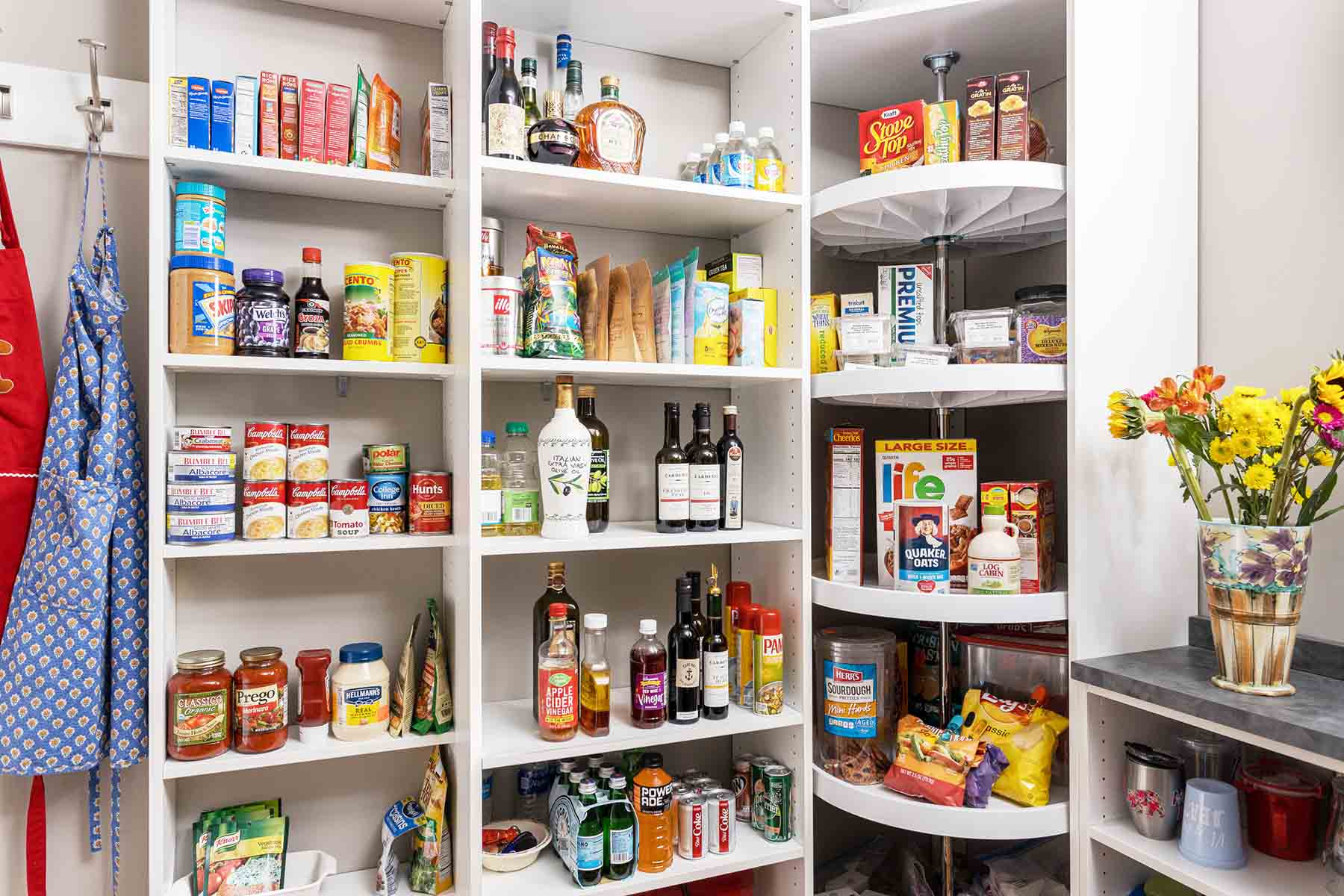 Organized pantry with custom shelves and cabinets