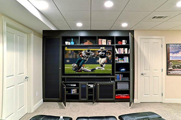 Entertainment center with media storage and custom cabinets