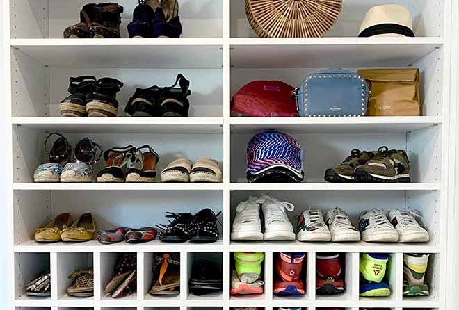 Shoes organized in cubbies an on custom shleves