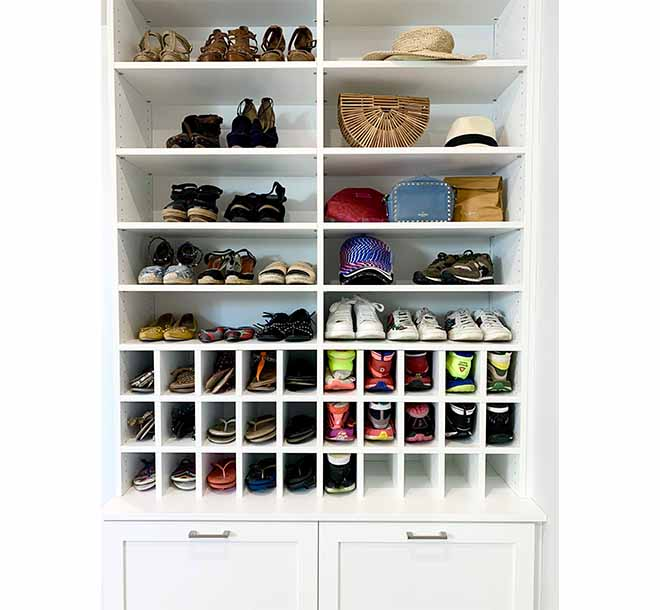 Shoes displayed and organized on shleves and cubbies