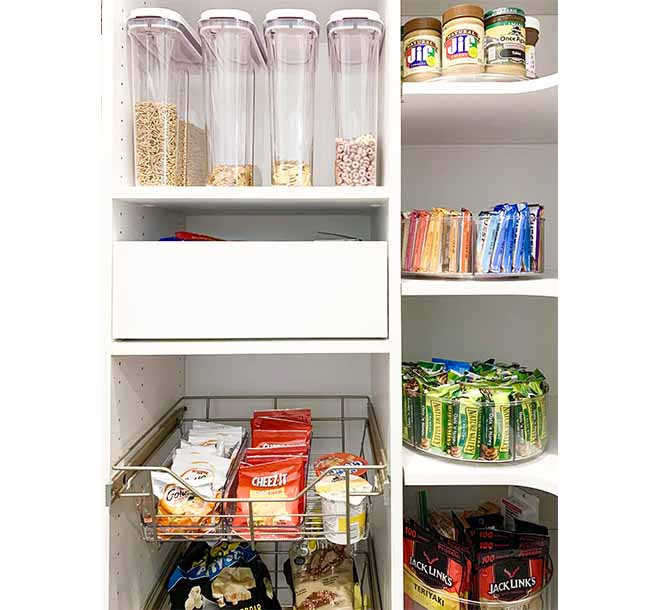 Corner shelving in pantry with food items organized