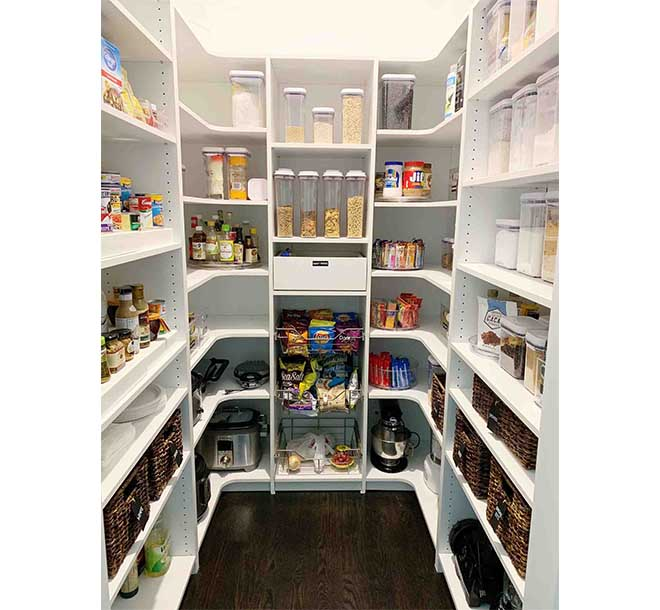Organized pantry with custom cabinets and shelves