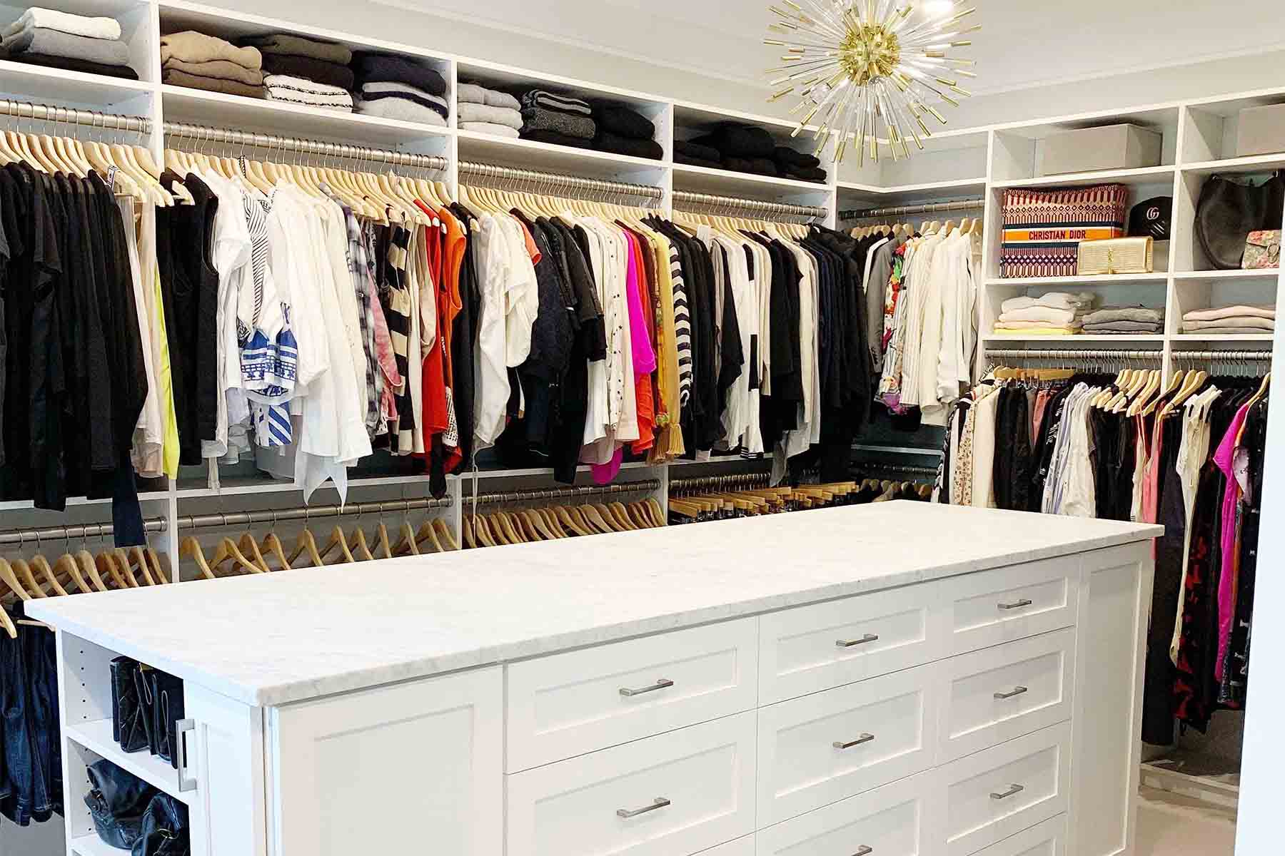 Organized clothes on double hanging rods