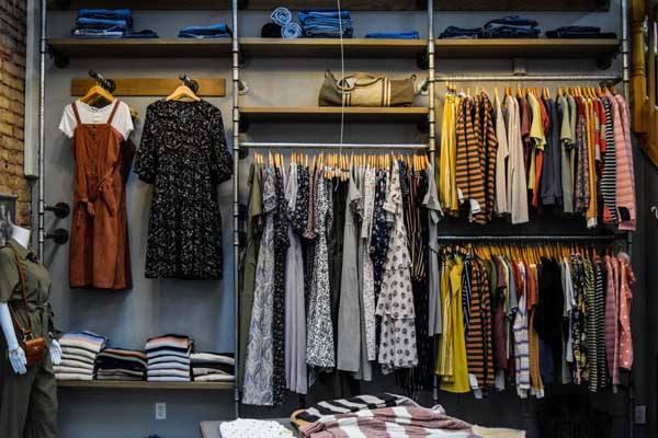 Organized closet with dresses hanging