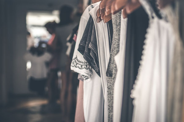 Dresses and blouses hanging in closet