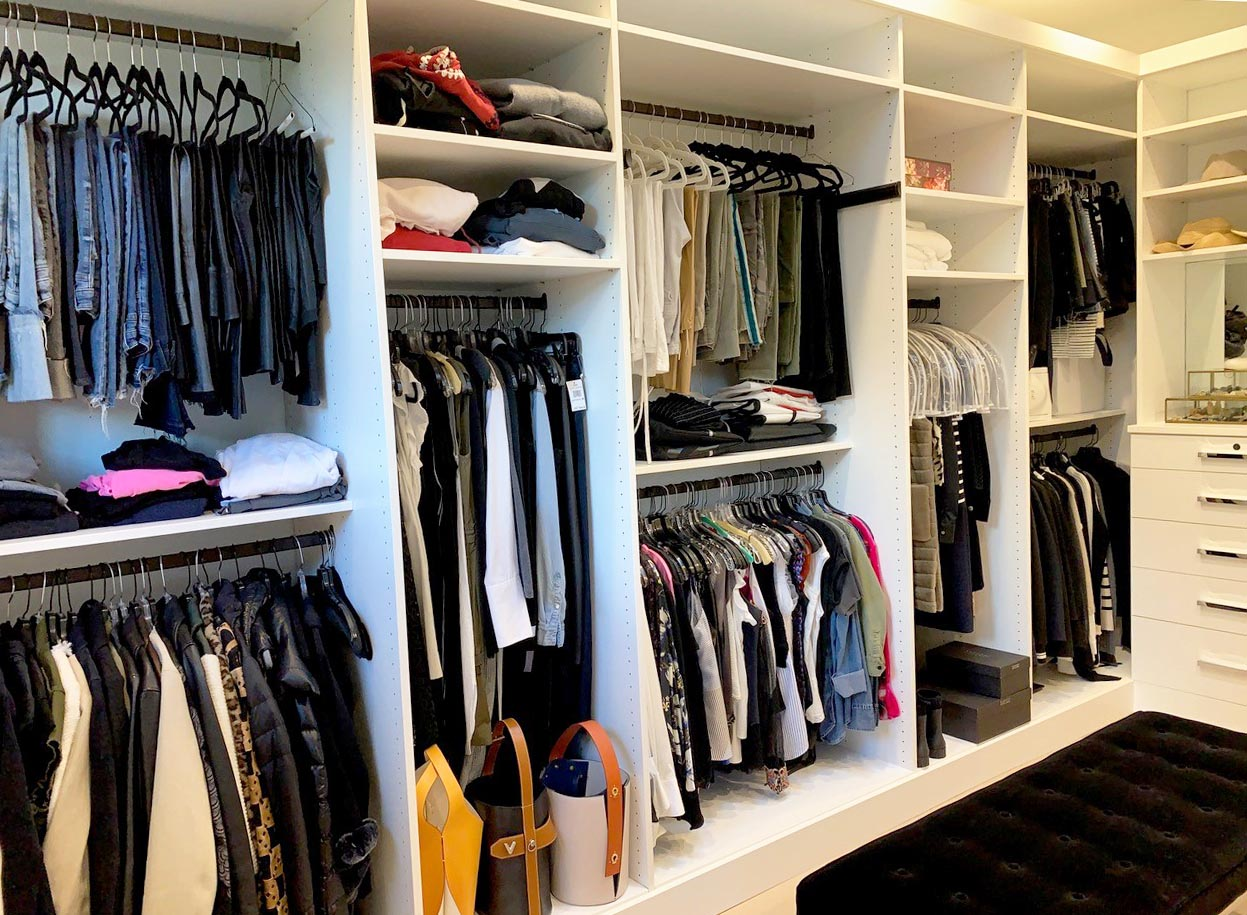 Organized closet with off season clothing stored