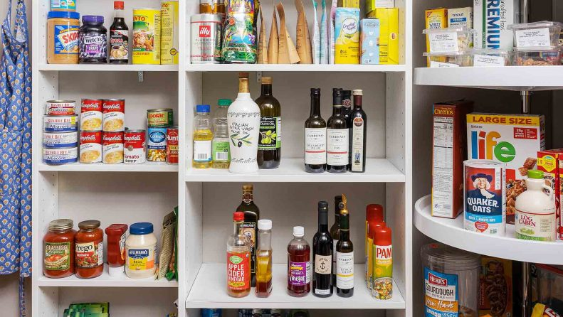 Pantry shelves with items organized