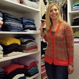 Happy customer standing in front of organized closet