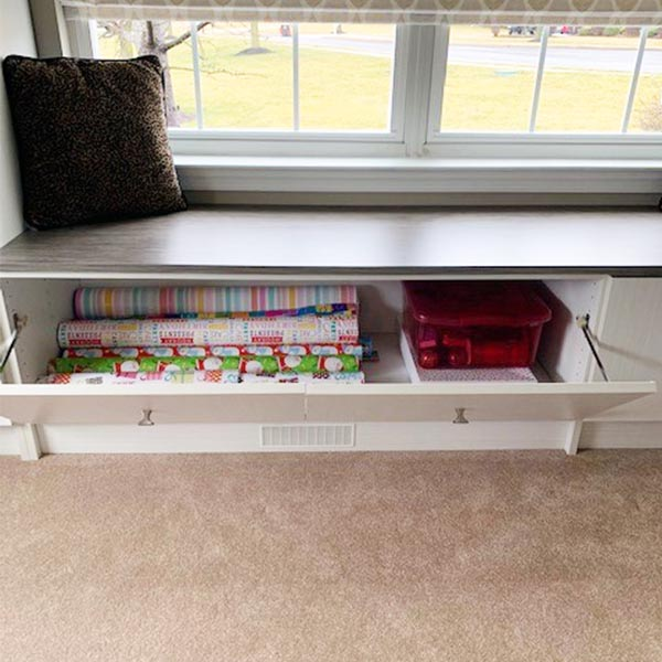 Wrapping paper stored and neatly organized in bench compartment