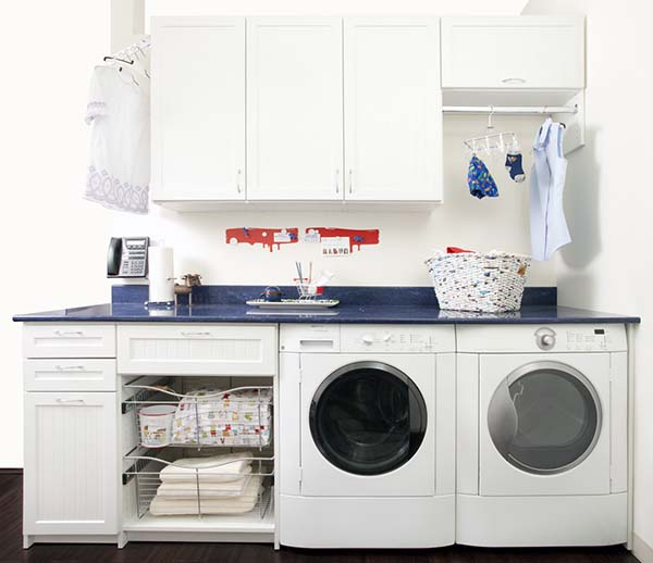 Organized laundry room with cabinets and baskets