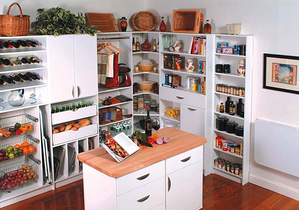 Walk-in pantry organized with open shelving and center island