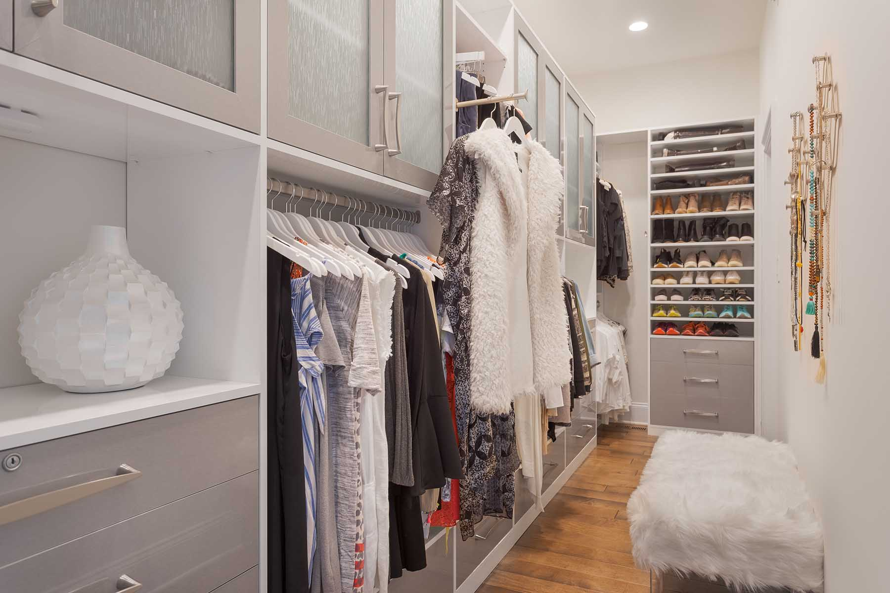 Walk-in closet with winter clothing organized