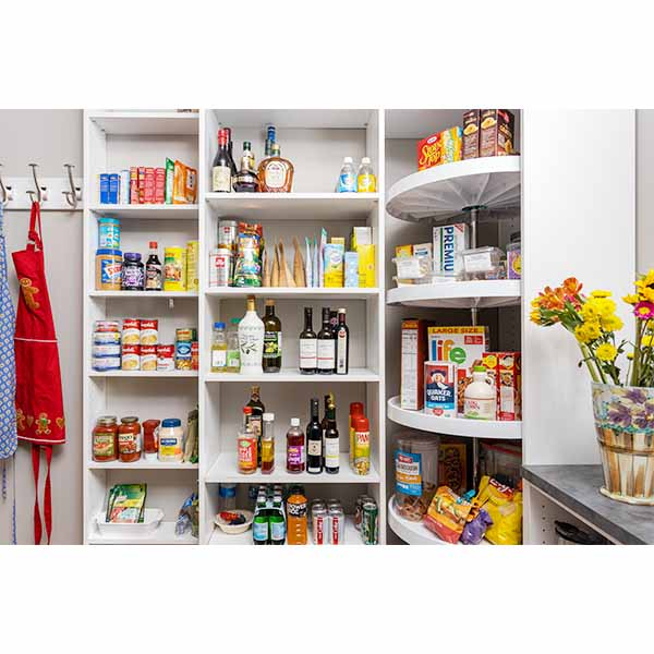 Organized kitchen pantry closet with custom shelves and Lazy Susan