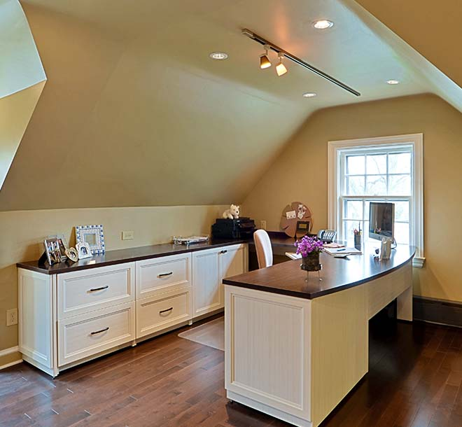 Home office design with custom built desk and cabinet furniture pieces