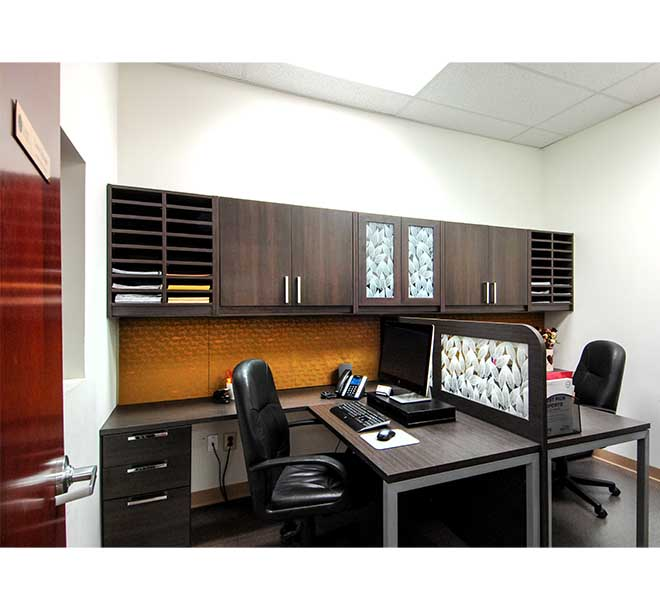 Office space designed for two people with desks and glass insert dividers