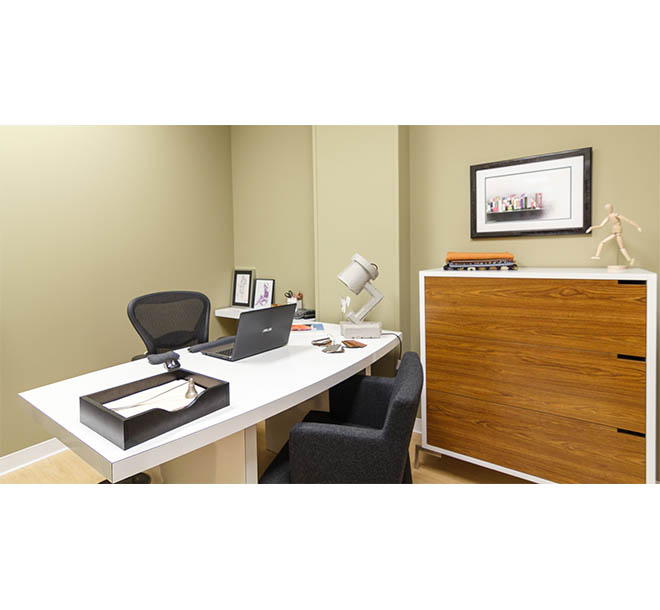 Home office with custom built desk and cabinets