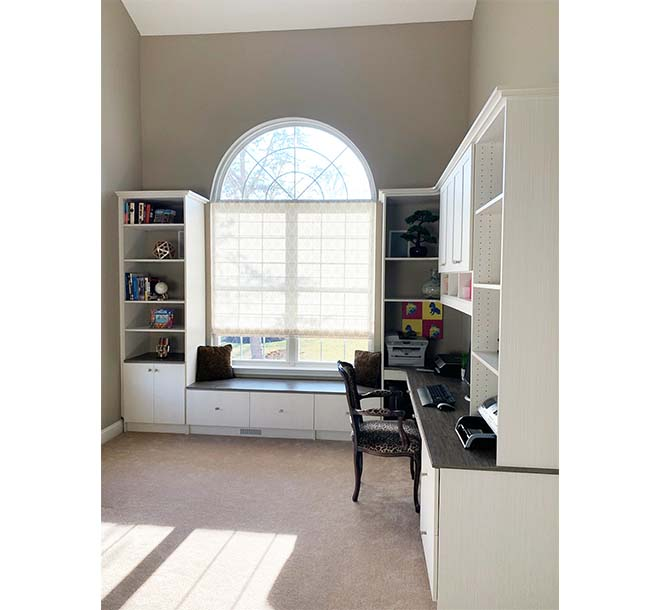 Customized home office cabinets around big picture window