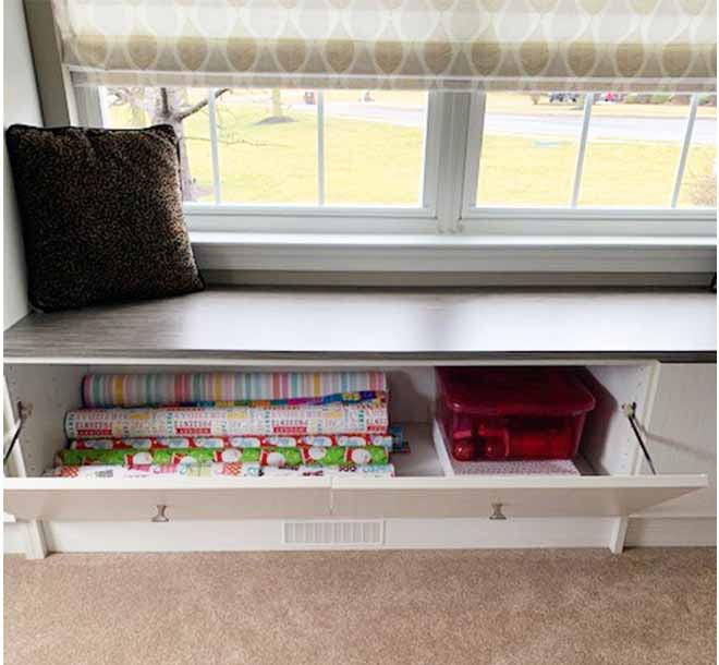Bench storage filled with art and craft supplies