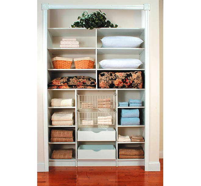 Reach-in closet with linens organized