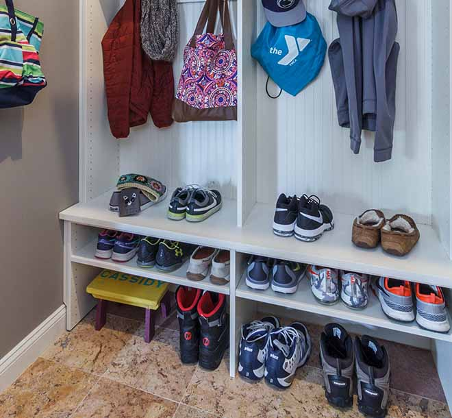 Mudroom wall unit with benches and shoe storage underneath