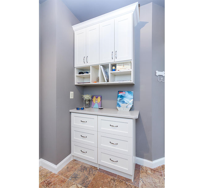 Custom built cabinet with counter and additional storage in entryway