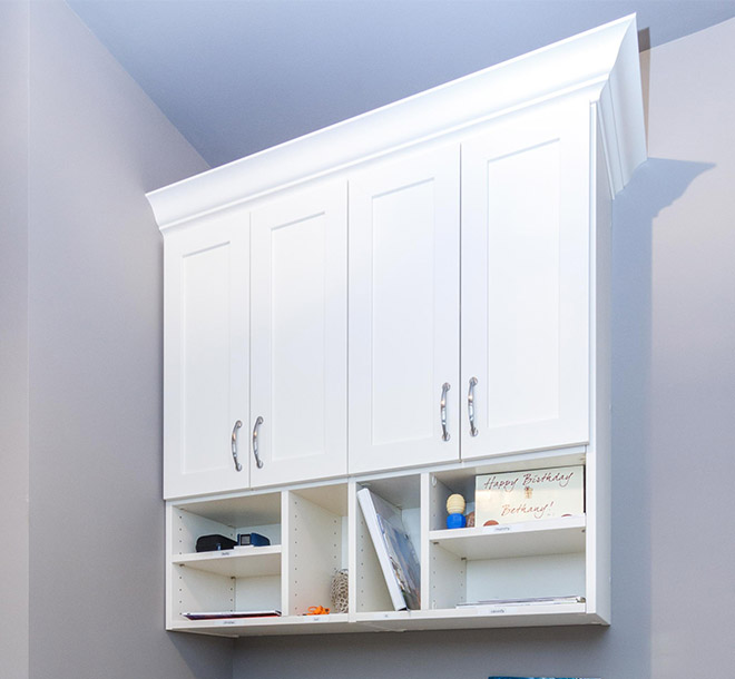 Top cabinet in entryway with shaker doors and custom shelves