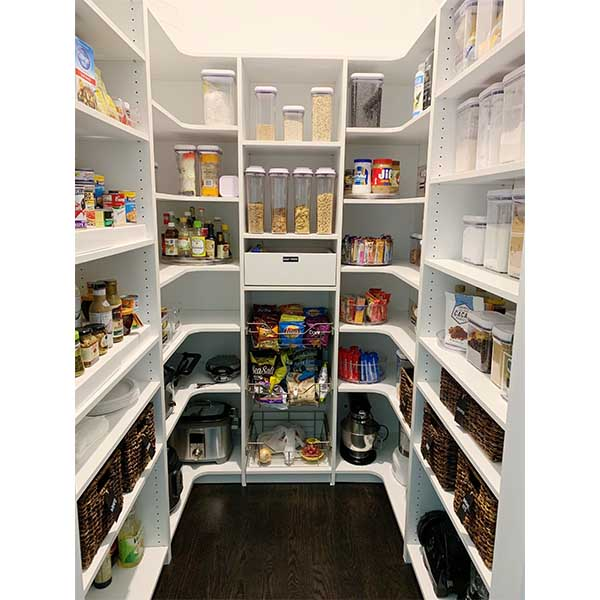 Custom built pantry design with corner shelving and wire roll out baskets