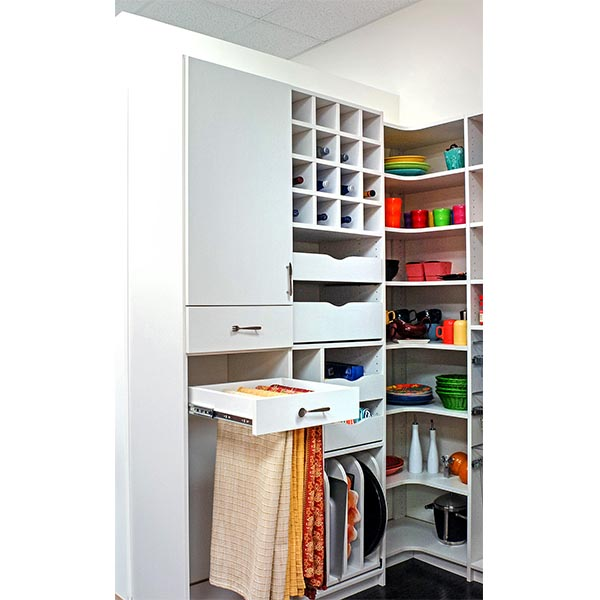 Pantry drawer open with tableclothes neatly organized and folded on vertical sliders