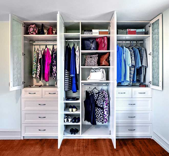 Wardrobe closet with clothing and shoes organized