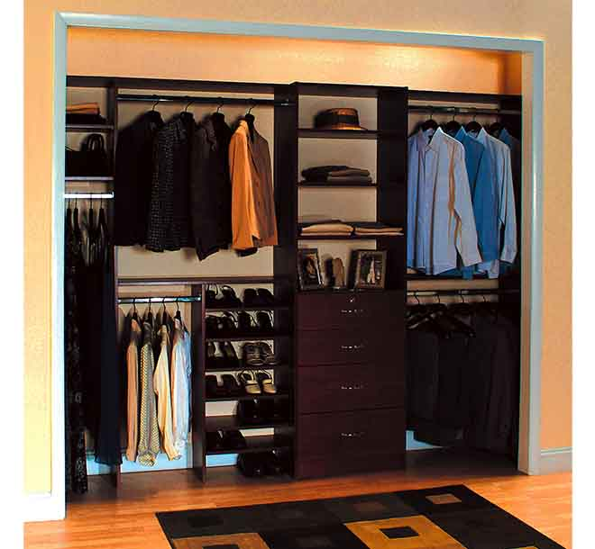 Mens reach in closet with jackets and shirts hung and organized