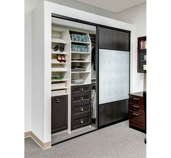 Reach in closet system with sliding glass doors open
