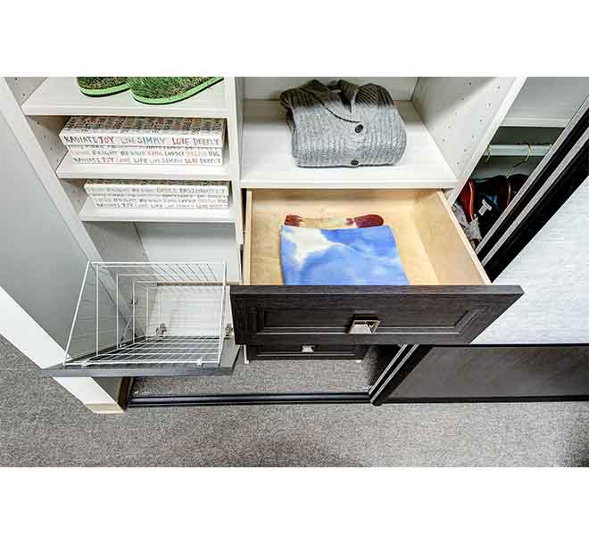 Closet drawer with clothing neatly folded and organized