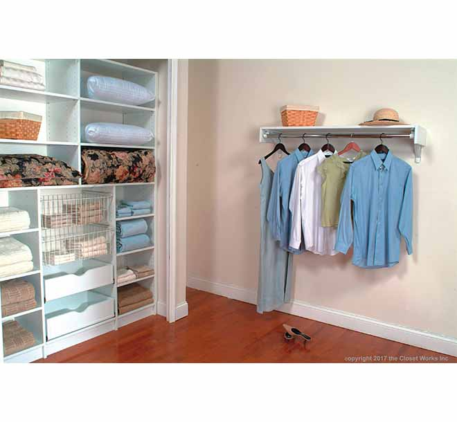 Linen closet with sliding baskets and cubbies organizing towels and bedding