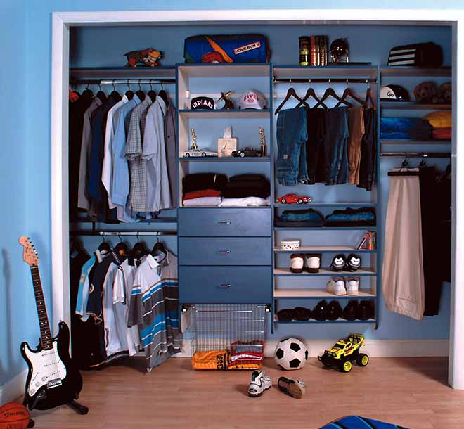Boys reach in closet with shirts and slacks hung and organized