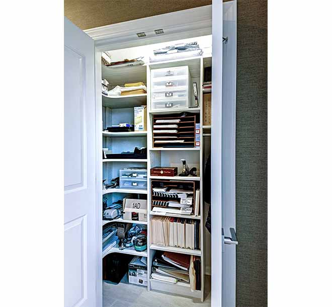 Small room reach in closet idea with rounded corner shelving maximizing the storage space
