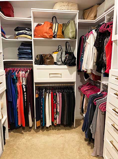 Clothes neatly organized nad hung in closet