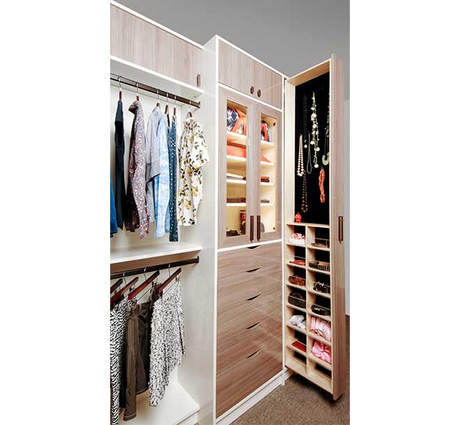 Walk-in closet with velvet lined vertical pull out drawers