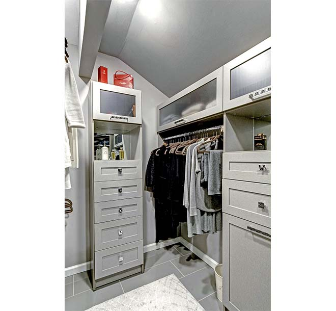 Custom walk-in closet cabinets with glass door inserts