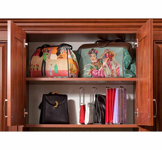 Custom closet cabinet with doors displaying and organizing hangbags