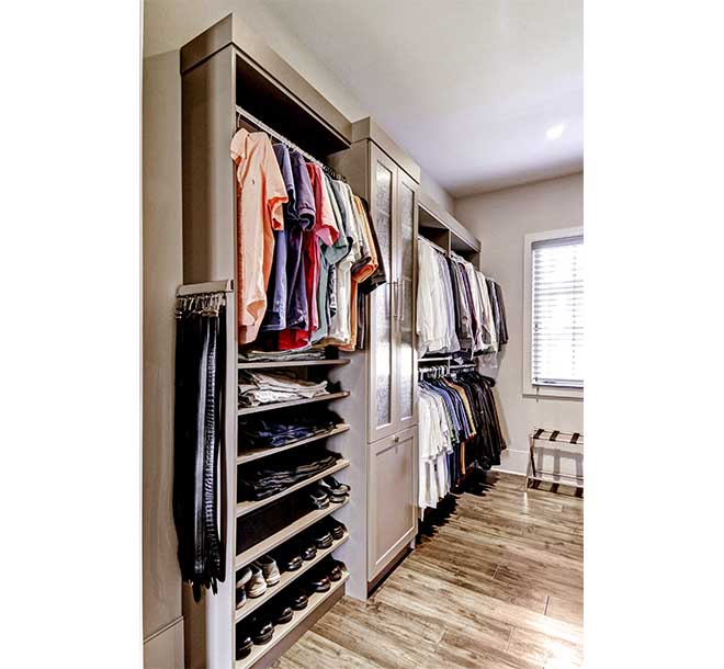 Custom walk-In closet design with clothing storage options