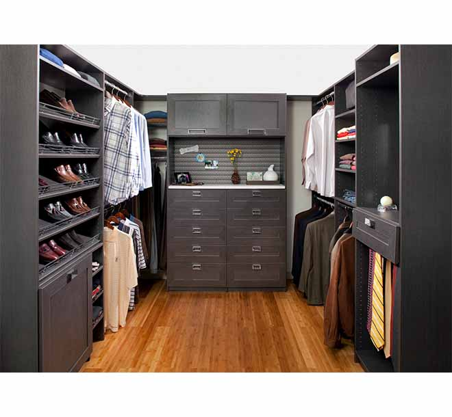 Custom walk-In closet with hardwood floors and various hanging sections