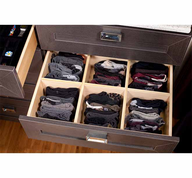 Open closet drawer with dividers and socks neatly folded