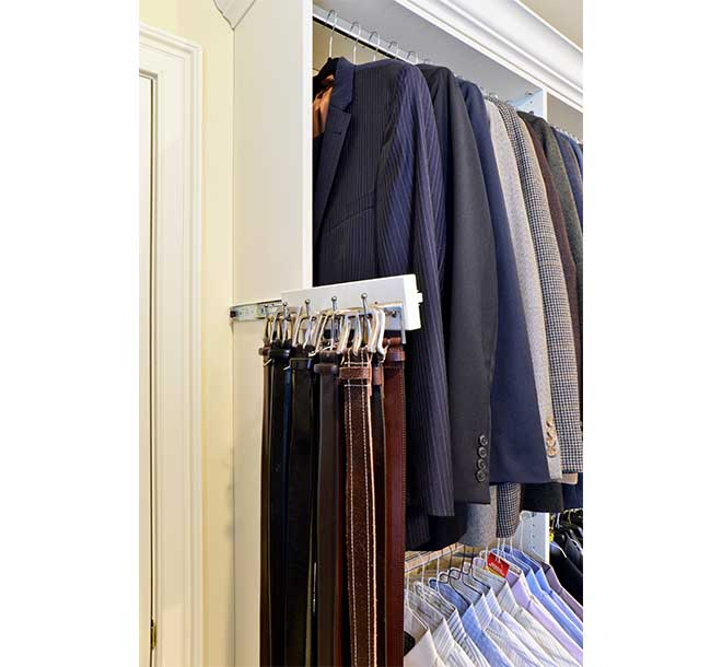 Slide out belt rack slid open with belts hung neatly