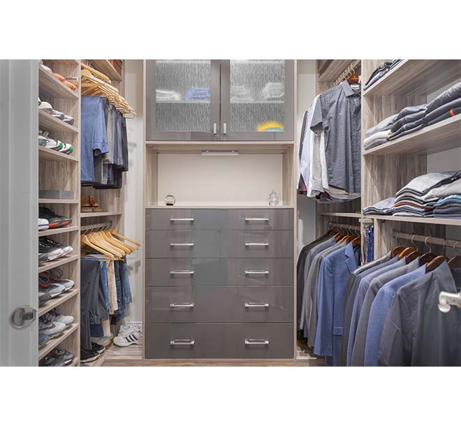 Men's built in closet idea with open shelving and counter space