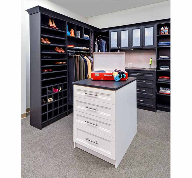 Walk-In closet with center island and various shoe storage options